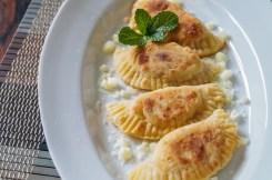 Kremmydopitarakia Milou (Greek Onion, Cheese, and Mint Crescents)
