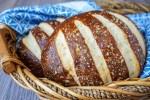 Two Pretzel Bread loaves in a wooden basket.