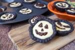 Cheesecake Tartlets with Jack o Lantern chocolate ganache faces.