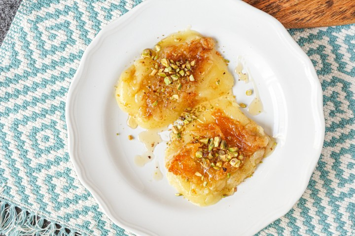 Kasseri Saganaki (Griddled Greek Cheese with Pistachios and Honey) on a plate