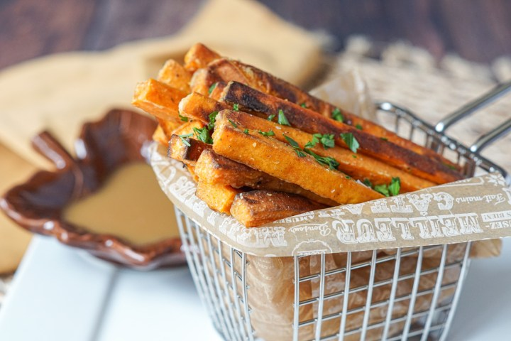 Spiced Sweet Potato Fries with Maple Mustard Dipping Sauce in a basket
