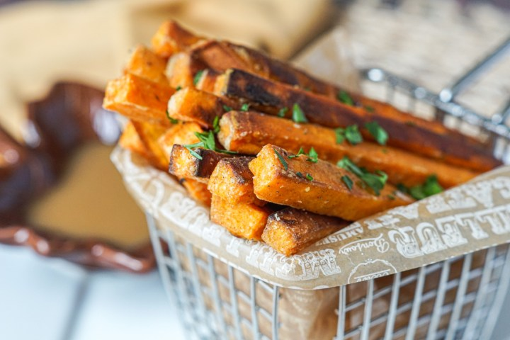 Spiced Sweet Potato Fries topped with salt and parsley