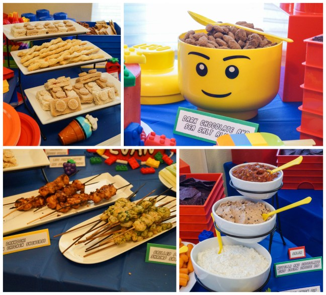 Lego sandwiches, chocolate almonds, kebabs, and dips on table.