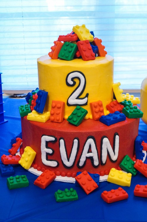 Two tier lego birthday cake with lego fondant bricks and Evan on first tier and 2 on second tier.