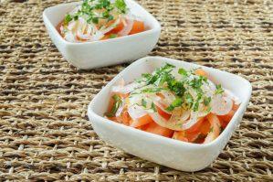 Ensalada Chilena (Chilean Tomato and Onion Salad) in two small white square bowls.
