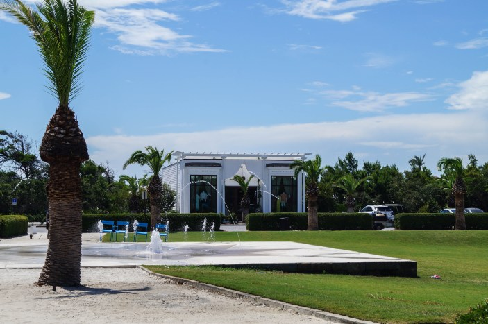 Amphitheatre in Alys Beach with a palm tree and splash pad.