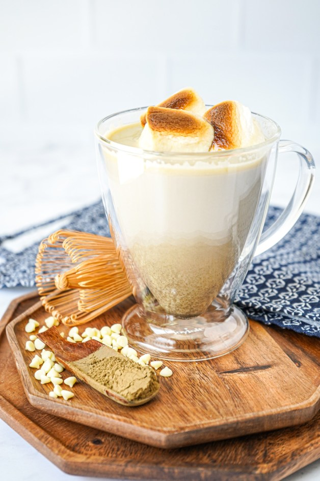 Hojicha Hot Chocolate in a clear mug with toasted marshmallows.
