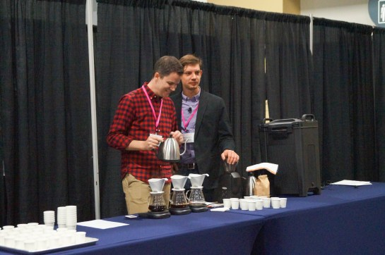Pouring coffee into cups at Travis Beckett's workshop.