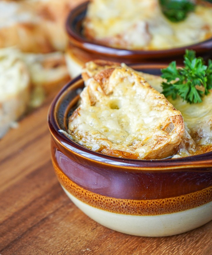 Guinness Onion Soup in three small brown bowls.