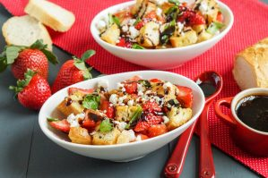 Strawberry Panzanella in two oval white bowls.