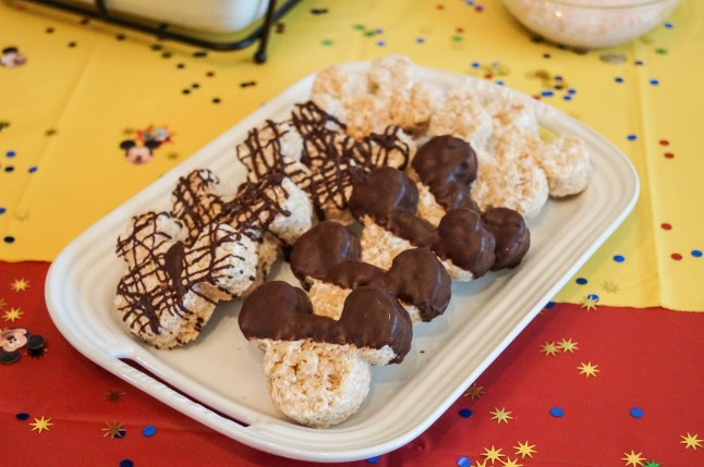 Mickey Mouse Rice Krispie Treats with chocolate on a white platter.
