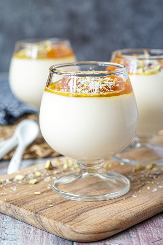 Malabi with Orange Brandy Sauce, pistachios, and coconut flakes
