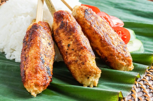 Sate Lilit Ayam (Balinese Chicken Satay) on a banana leaf