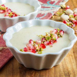 Mishti Dohi (Indian Baked Sweet Yogurt Cream) in two white ramekins.