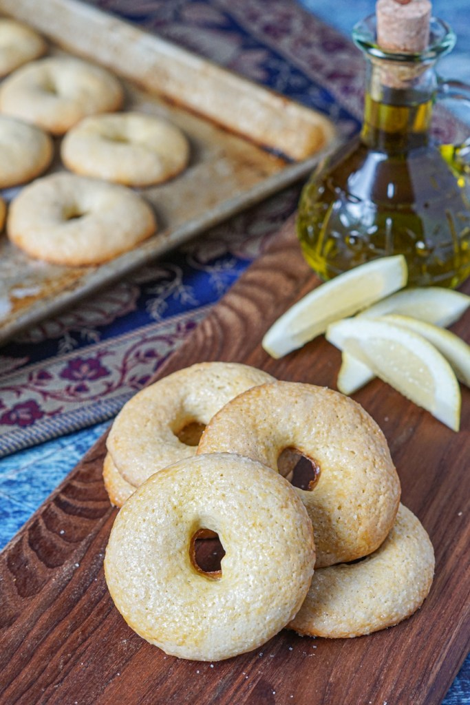 Twabaa (Algerian Lemon and Olive Oil Cookies) on a board and cookie sheet