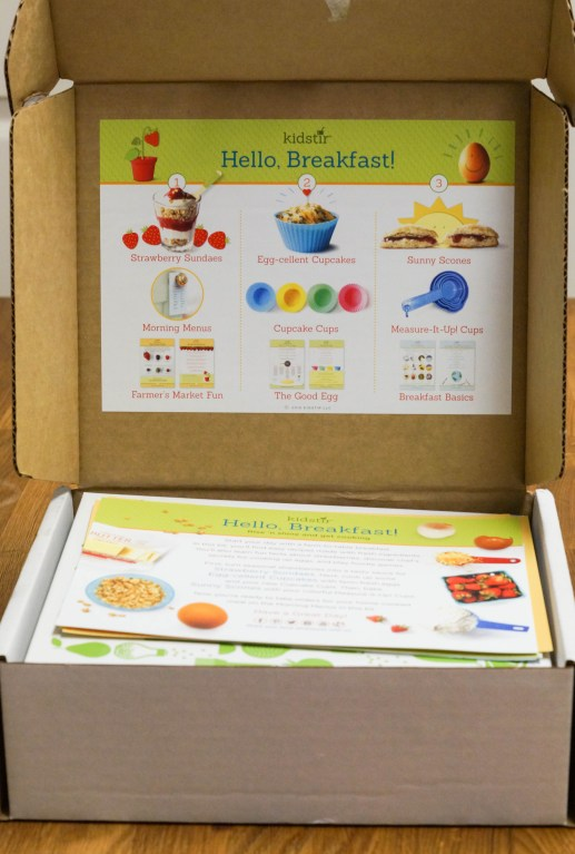 Opening the Kidstir Hello, Breakfast box with a list of three recipes and ingredients.