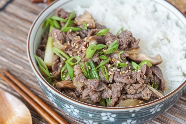 Bulgogi Dupbap (Korean Soy Garlic Beef over Rice) in a bowl