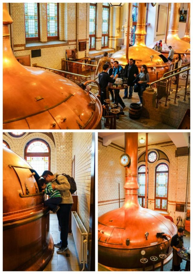 Large copper beer vats inside The Heineken Experience.