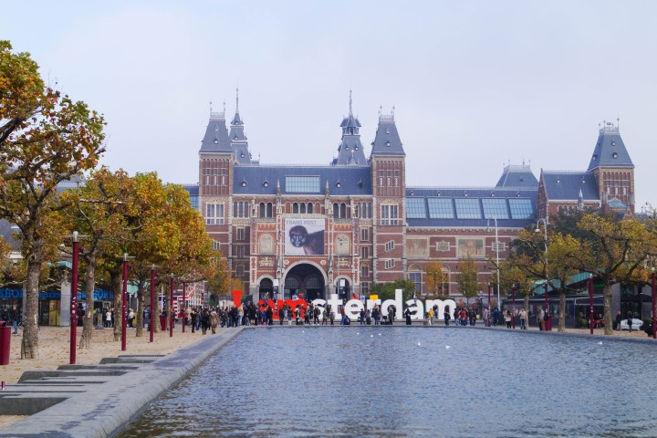 Outside of Rijksmuseum with I Amsterdam sculpture and water lined with trees