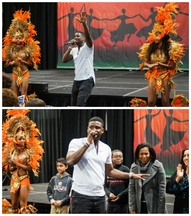 Julien Believe singing next to dancers from The Bahamas