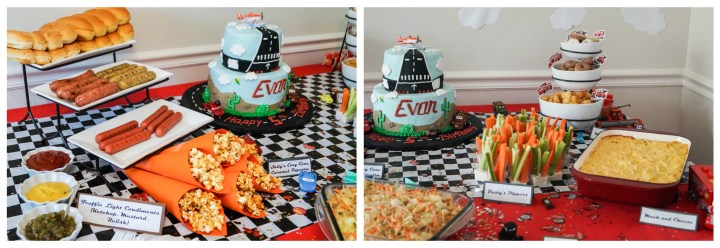 Spread of food on a red and black/white checkerboard table with hotdogs, popcorn, vegetables, and a cake.