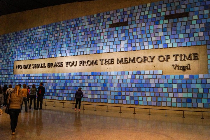 """Wall with words- """"No Day Shall Erase You From The Memory of Time- Virgil."""