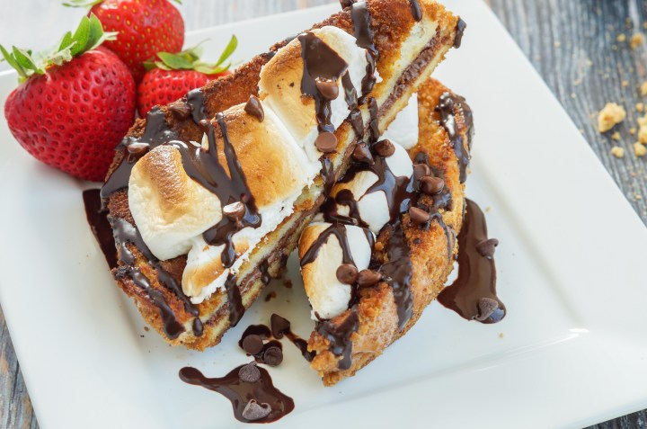 S'mores French Toast with chocolate sauce and strawberries