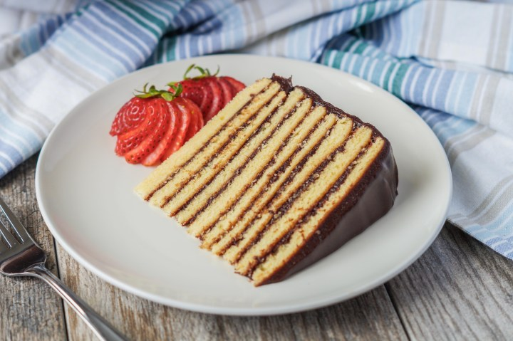 A slice of Smith Island Cake with strawberries