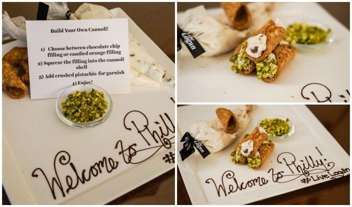 "Build your own cannoli set on a white plate with ""Welcome to Philly  #LiveLogan"" written in chocolate."