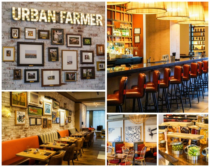 Urban Farmer restaurant at The Logan Hotel with red stools lined up at a bar, booths, and Urban Farmer sign.