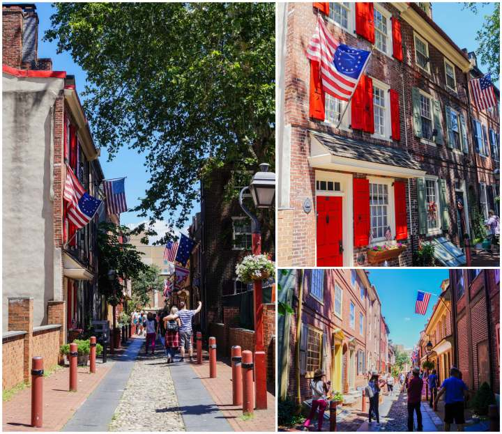 Elfreth's Alley in Philadelphia with flags and brick houses.
