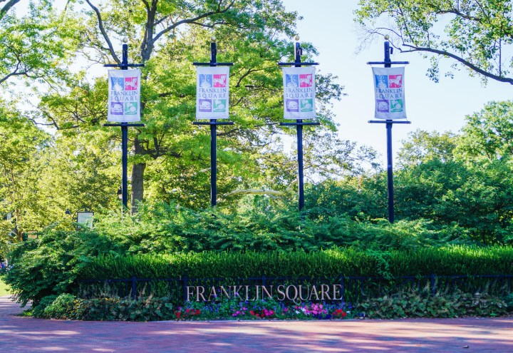 Entrance to Franklin Square with four banners over the Franklin Square sign.