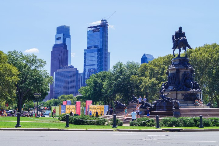 View of the park outside the Philadelphia Museum of Art with tall blue buildings in the background.