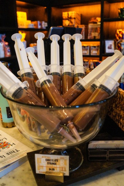 Bowl filled with chocolate syringes at Max Brenner.