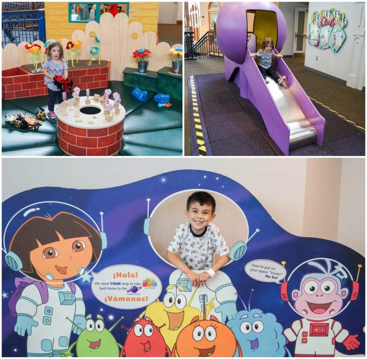 Dora exhibit with space cutout, flower garden, and purple slide at Port Discovery.