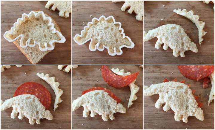 Forming the stegosaurus sandwich for the Dinosaur Bento- cutting out the stegosaurus shape with a cookie cutter and cutting out the top layer of the stegosaurus plates with pepperoni slices.