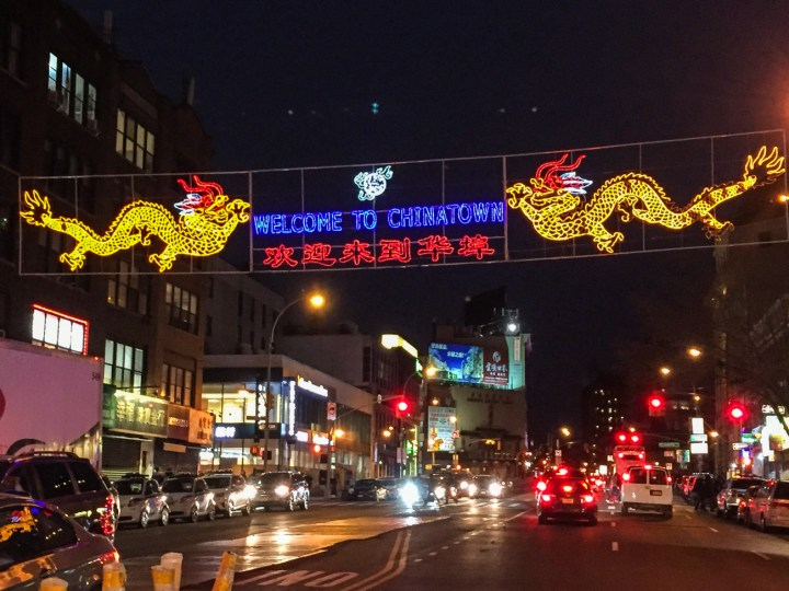 Welcome to Chinatown Sign with two yellow dragons over the street.