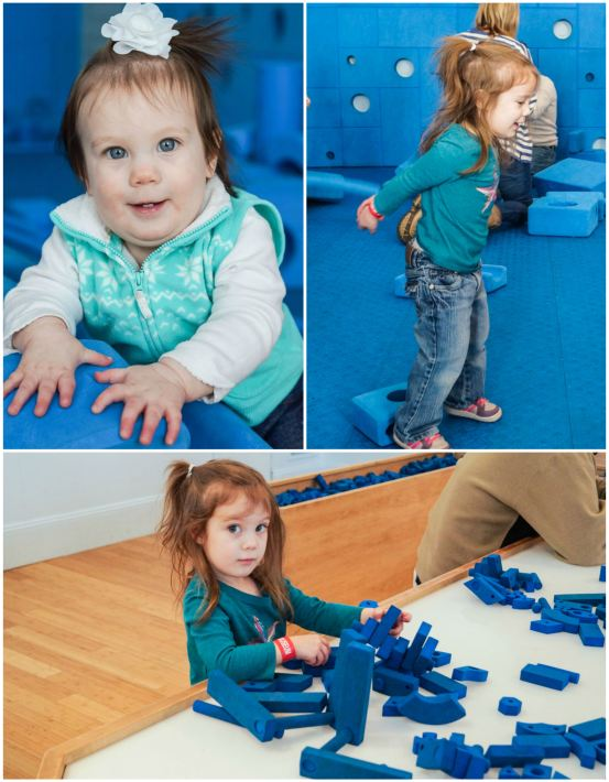 Playing with blue foam blocks in the Play Work Build exhibit.