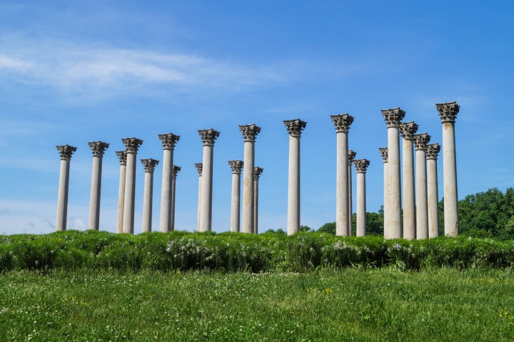 National Capitol Columns behind a green field