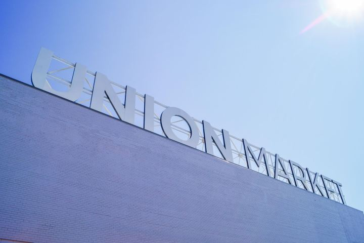 White Union Market sign on the top of the building