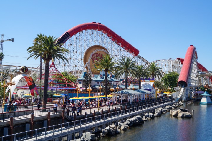 White and Red wooden roller coaster at Pixar Pier