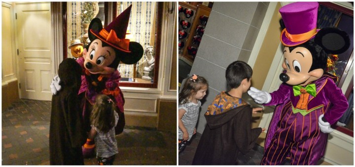 Hugging Minnie Mouse and Mickey Mouse in purple halloween costumes