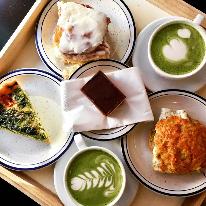 Matcha latte, sandwich, cinnamon roll, and pastries at A Baked Joint