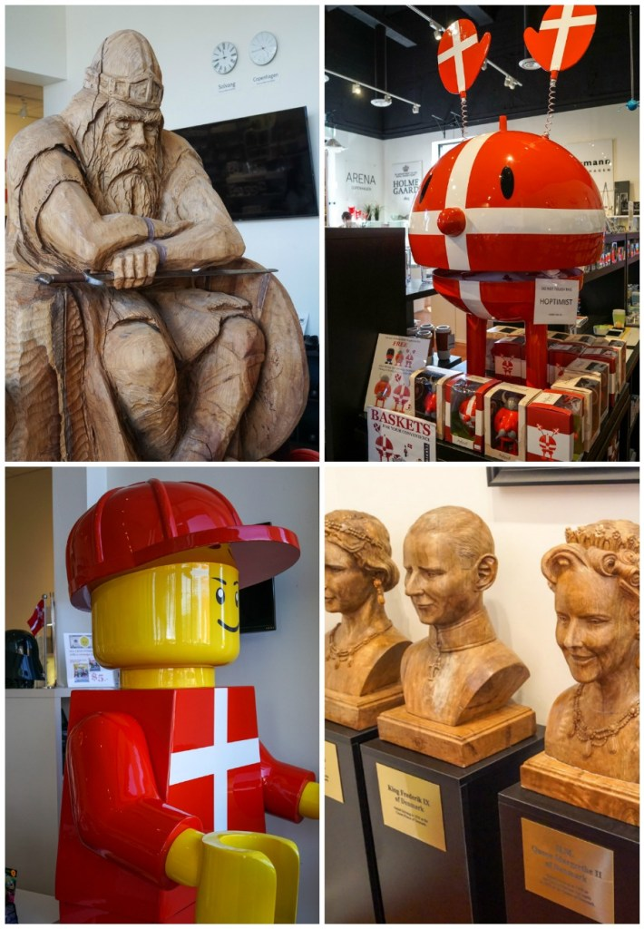 Inside The Copenhagen House- replica of Holger Danske, big lego man, Danish red and white flag on toys, and busts of Danish leaders.