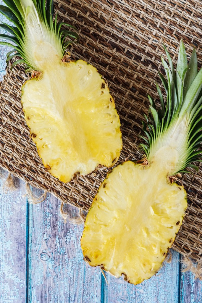 A small pineapple sliced in half