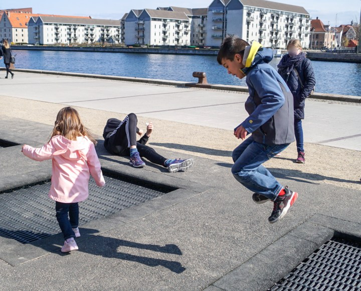 Jumping on the sidewalk trampoline in Copenhagen