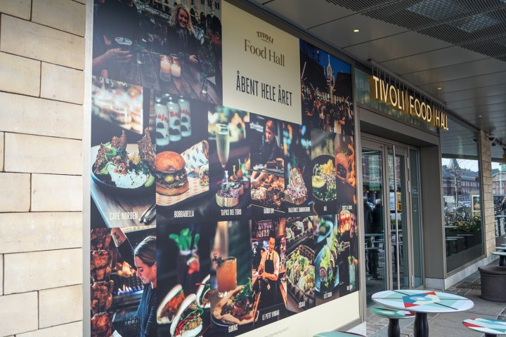 Outside of Tivoli Food Hall with poster of food.