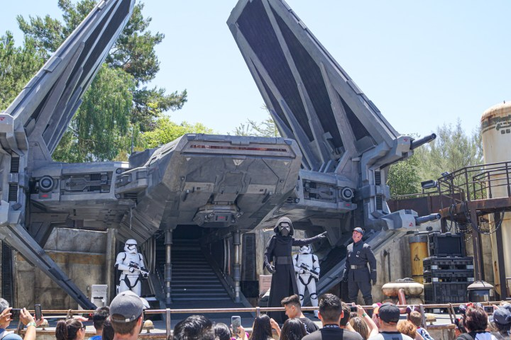 Kylo Ren and Stormtroopers standing in front of his ship