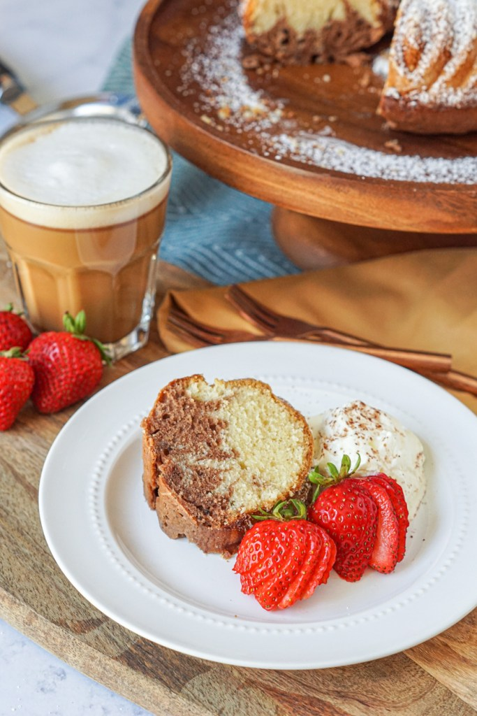 Ciambella Del Mattino (Morning Bundt Cake) on a plate with strawberries