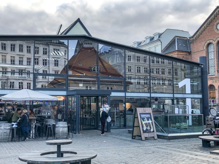 Outside the glass entrance to Torvehallerne